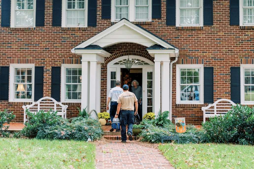 Euliss technicians entering house